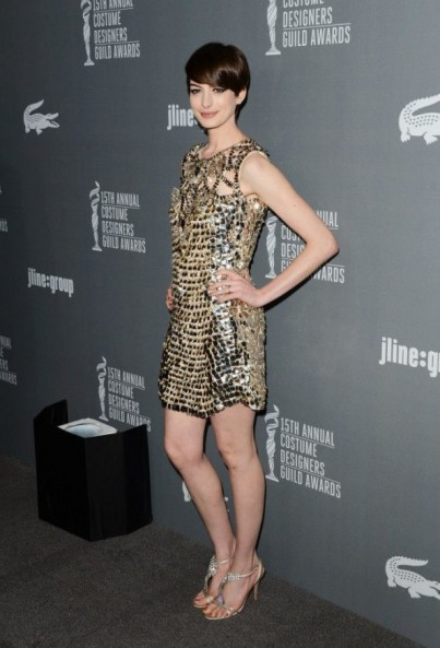 Actress Anne Hathaway wearing Gucci gold dress